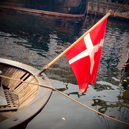 Boat and Danish flag seen in Nyhavn, Copenhagen